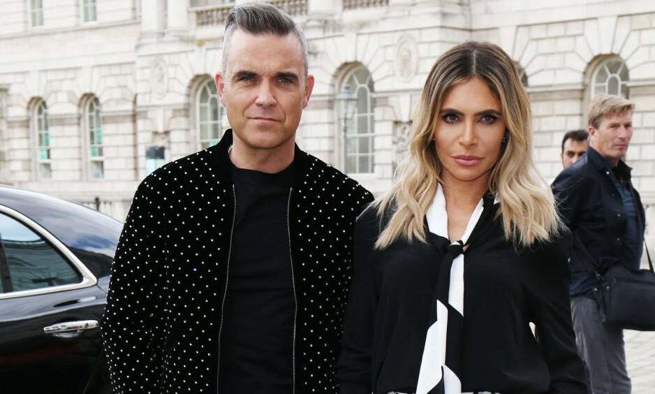SUPERSTJERNE SOM SLITER: Den karismatiske popstjernen Robbie Williams åpner seg om sitt dårlige selvbilde. Her med kona Ayda Williams. Foto: NTB Scanpix