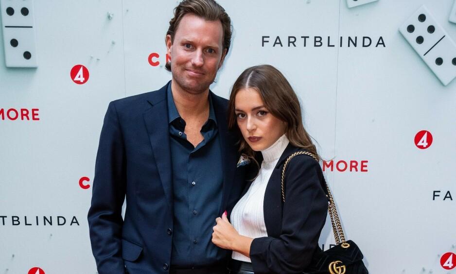 MILLIARDER PÅ BOK: H&M-arving Nils Tham, her fotografert med kjæresten Felice Jankell i sommer, er en diskré mann. Han vekker likevel til stadighet oppsikt på grunn av sine dyre investeringer og partyliv. Foto: NTB scanpix