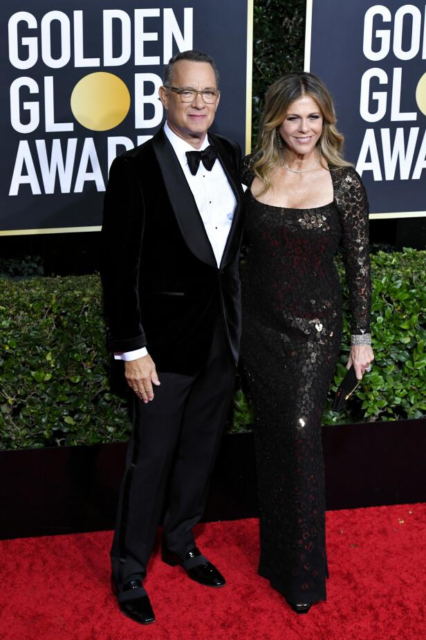 <strong>PÅ PLASS:</strong> Tom Hanks og Rita Wilson på den røde løperen, til tross for startvansker for sistnevnte. Foto: NTB Scanpix