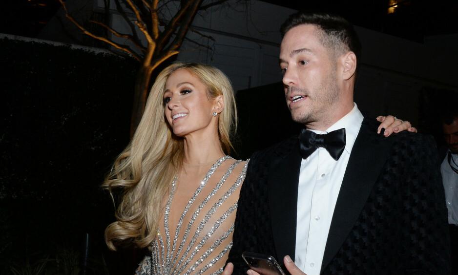LYKKELIG IGJEN: I løpet av kort tid skal det ha blitt seriøst mellom Paris Hilton og jevnaldrende Carter Reum. Her er de sammen under årets Golden Globe Awards. Foto: NTB Scanpix