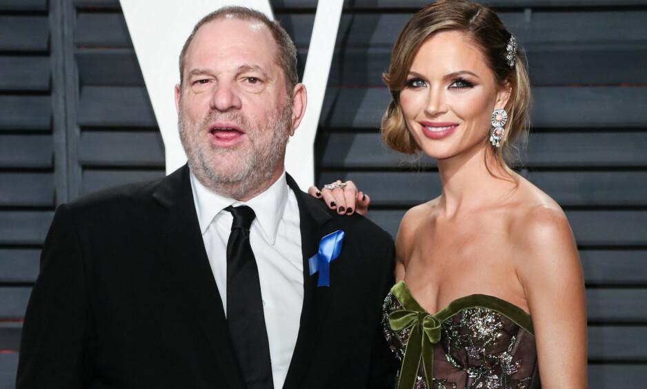 SMITTET: Den tidligere Hollywood-mogulen Harvey Weinstein skal ifølge en amerikansk avis være smittet av koronaviruset. Opplysningen er ennå ikke bekreftet, og tilstanden hans er ikke kjent. Her avbildet sammen med eskona Georgina Chapman i 2017. Foto: Mark Lennihan / AP / NTB scanpix