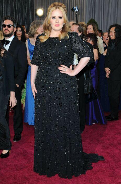 PRISVINNER: Adele har vunnet en rekke priser for musikken sin. Her under Oscar-utdelingen i 2013. Foto: NTB Scanpix
