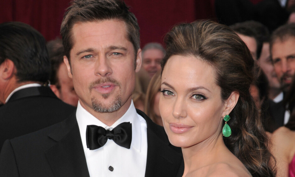 SKILT: Her er Brad Pitt og Angelina Jolie sammen under Oscar-utdelingen i Los Angeles i 2009 mens de enda var et par. Foto: NTB Scanpix