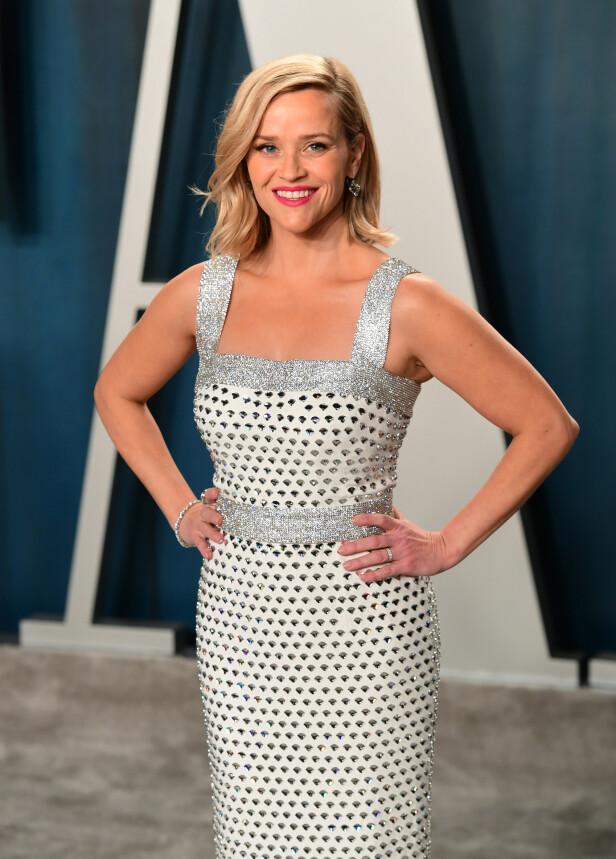 KREVER ERSTATNING: Reese Witherspoon og klesfirmaet hennes saksøkes for blant annet ikke å informere om at det bare var 250 kjoler som skulle gis bort. Foto: NTB Scanpix