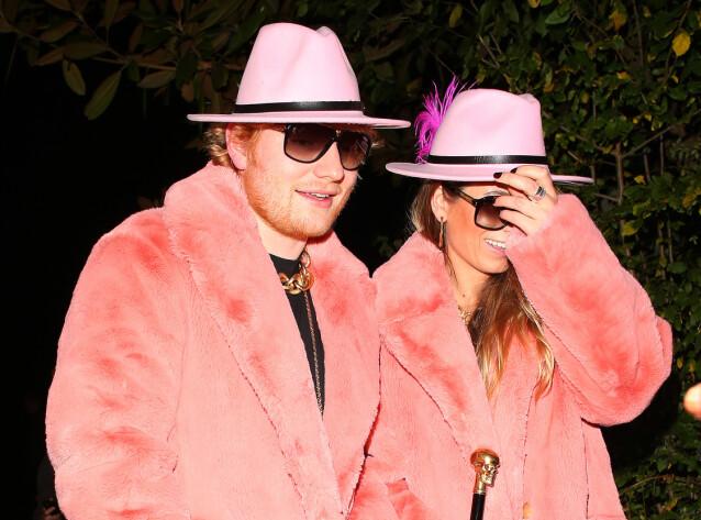 MEDIESKY: Sheeran er kjent for å holde en nokså lav profil. Her er han avbildet med kona i London i anledning en Halloween-fest. Foto: NTB Scanpix