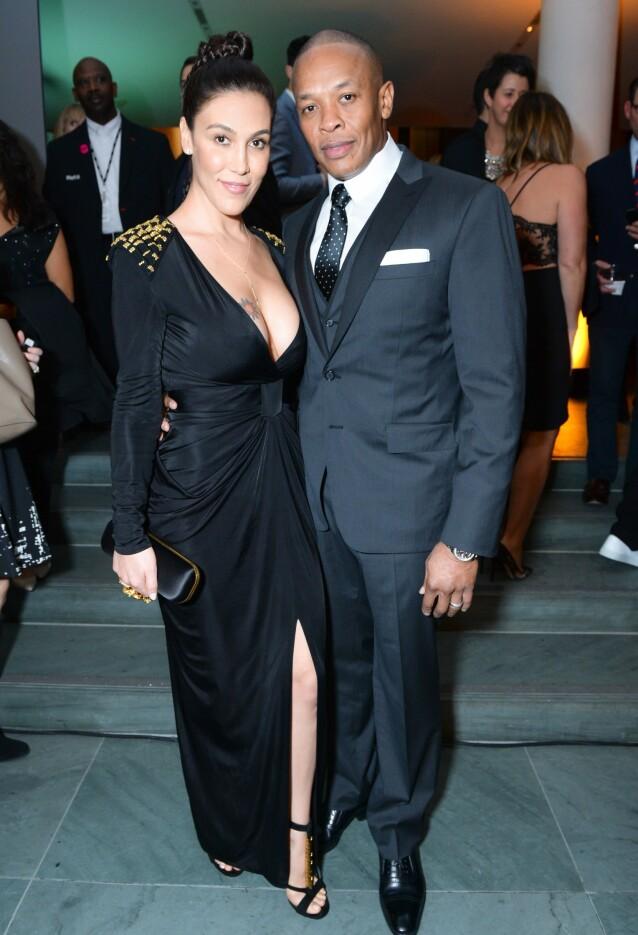 <strong>ENORM RIKDOM:</strong> Ifølge Forbes har Dr. Dre en formue på omlag 740 millioner dollar - eller cirka 6,6 milliarder norske kroner. Her er han og Nicole Young sammen på WSJ Innovator of the Year Awards i 2014. Foto: BFA/ REX/ NTB scanpix
