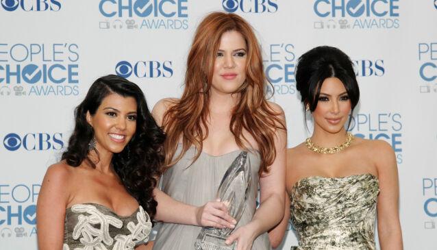 FAVORITTER: Opp gjennom årene har fansen latt seg bergta av Kourtney, Khloé og Kim Kardashian. Nå varsler sistnevnte at TV-eventyret er over. Her fotografert i 2011. Foto: NTB Scanpix