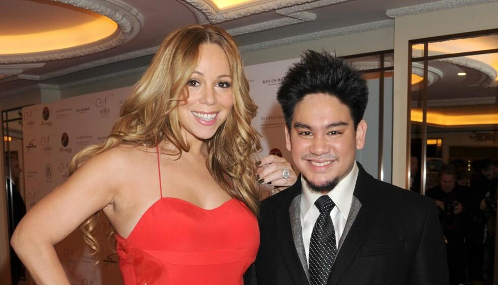 CELBER OMGANGSKRETS: Prins Azim hadde en rekke berømte venner. Her er han med sanger Mariah Carey i 2011. Foto: Richard Young / Rex / NTB