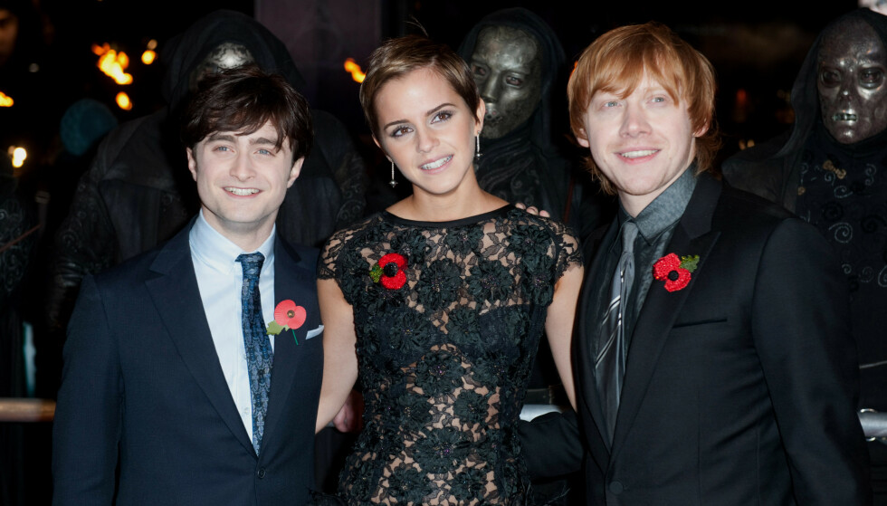 FIKK EN DATTER: Her er Rupert Grint (t.h) sammen med Harry Potter-kollegaene Daniel Radcliffe og Emma Watson på premieren Deathly Hallows: Part 1 i London i 2010. Foto: NTB
