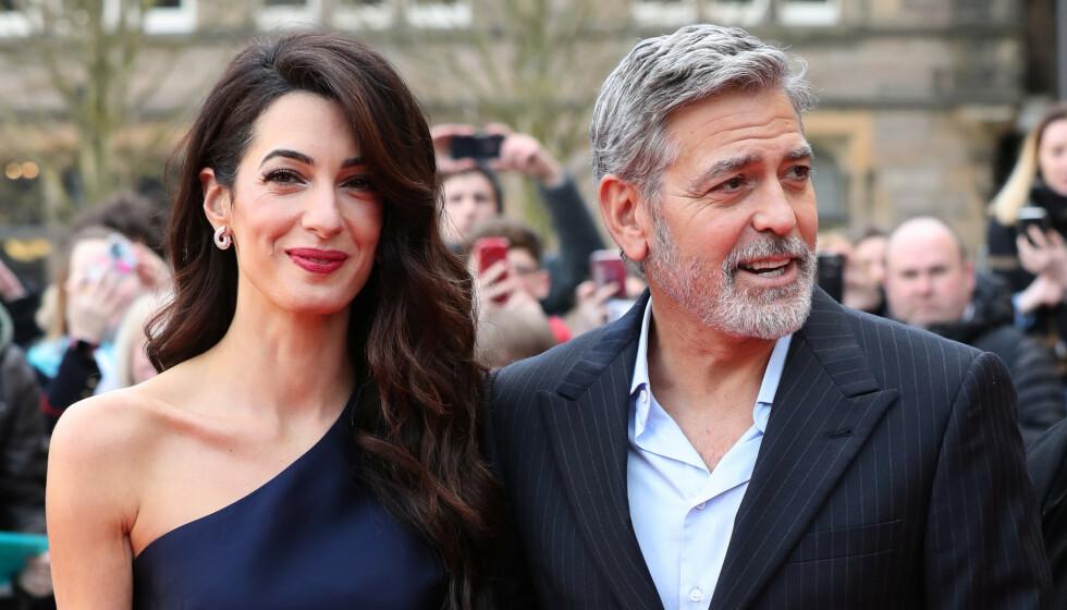 STJERNEPAR: Amal og George Clooney har vært et par i syv år. Sammen har de også tvillinger. Bildet er tatt i fjor sommer. Foto: NTB