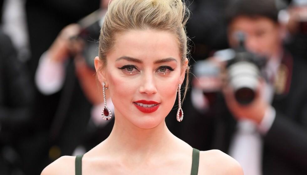 I RETTEN: Amber Heard, her fra retten i London, hevder at eksmannen var voldelig mot henne. Foto: James Gourley/REX/NTB