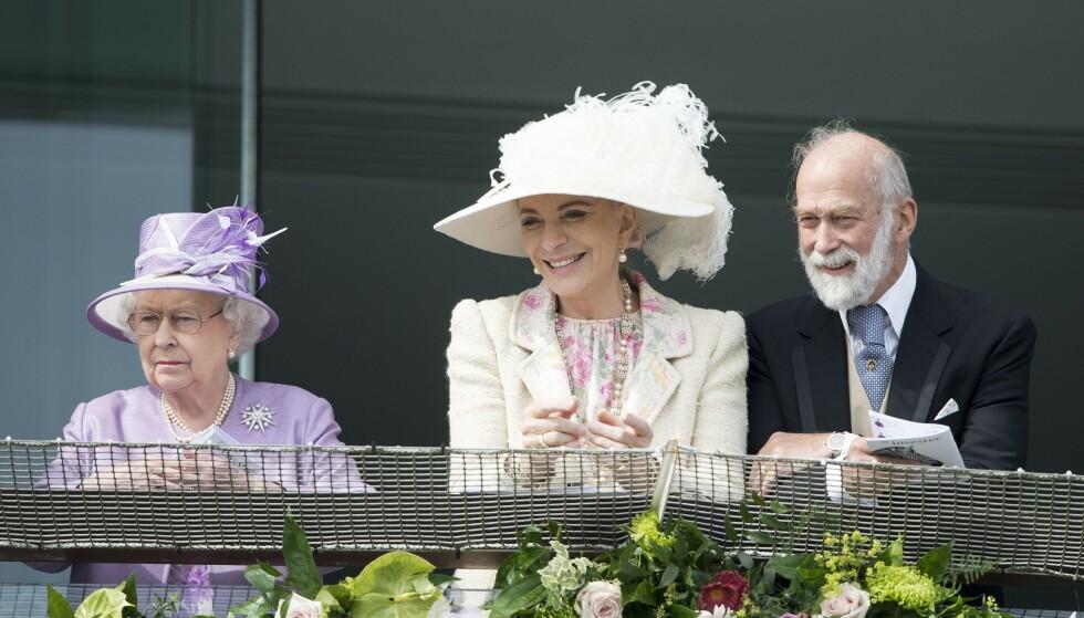 DRONNINGA: Prinsesse Michaels ektemann er dronningens fetter. Her er de tre sammen i 2014. Foto: Shutterstock / Rex