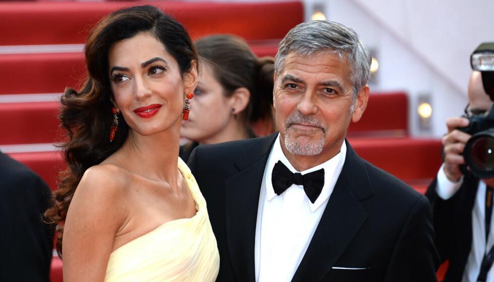 BETENKNINGSTID: Da George Clooney gikk ned på et kne og fridde til Amal Clooney gikk det ikke helt etter planen. Foto: Anthony Harvey / REX / NTB