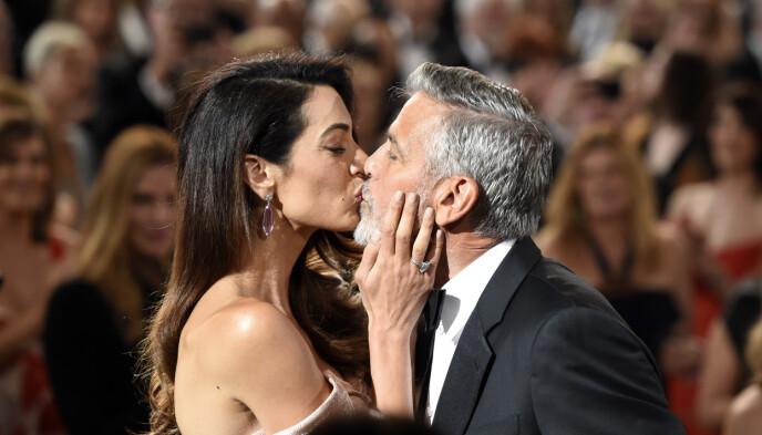 LYKKELIG SLUTT: Til tross for at George Clooney fryktet det verste da Amal måtte tenke seg om, giftet de seg til slutt. Foto: Chris Pizzello/Invision/AP/NTB