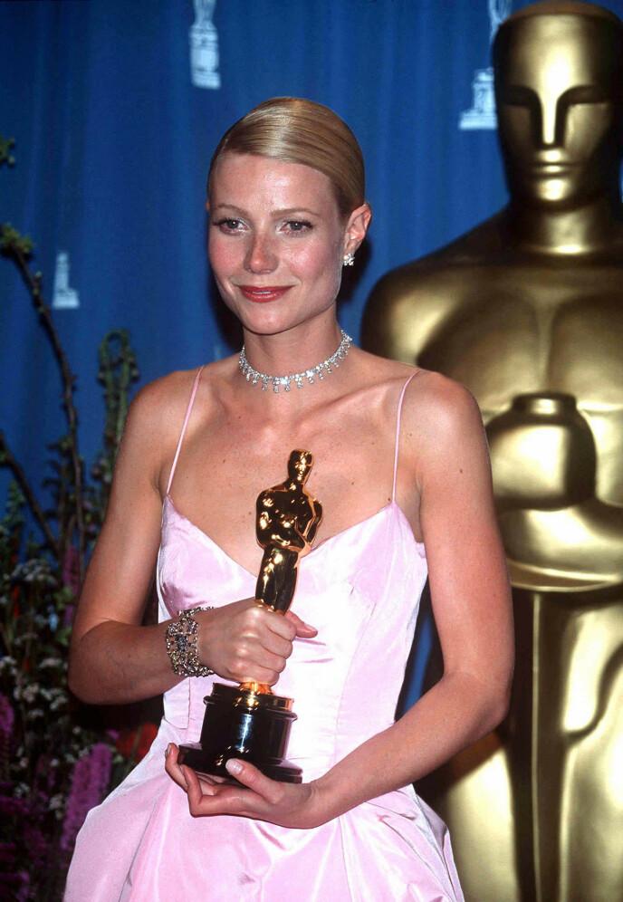 PRISVINNER: I 1999 mottok Gwyneth Paltrow sin første Oscar. Foto: REX / NTB