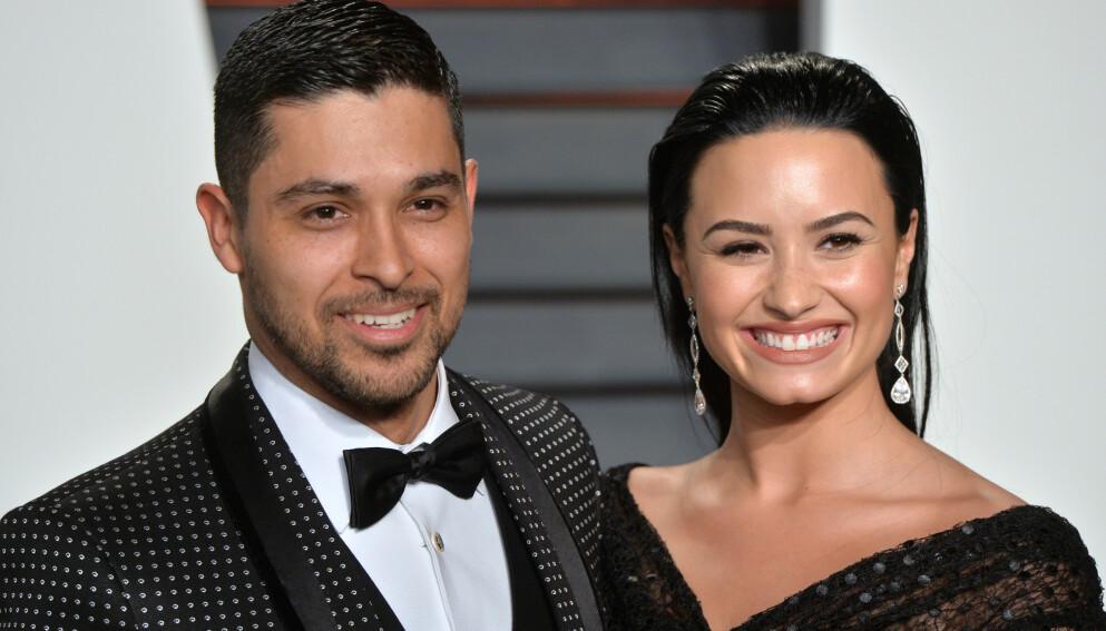 EKS-KJÆRESTER: I seks år var Wilmer Valderrama sammen med popstjernen Demi Lovato. Nå venter han barn med forloveden Amanda Pacheco. Foto: Anthony Harvey/REX/NTB
