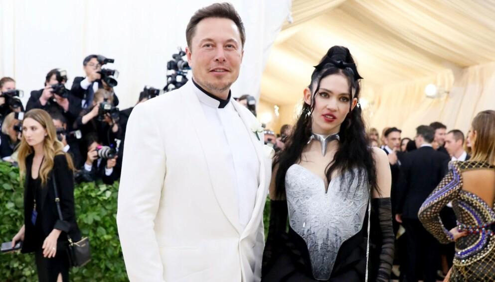 CORONASMITTET: Sangeren og låtskriveren Grimes avslører at hun har fått påvist corona. Her avbildet med kjæresten og Tesla-gründeren Elon Musk i 2018.Foto: Benjamin Lozovsky / Shutterstock Editorial / NTB