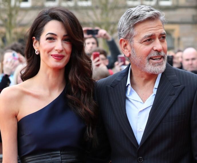 EKTEPAR: George Clooney roser stadig kona Amal opp i skyene. Her er de avbildet i 2019. Foto: Andrew Milligan / Pa Photos / NTB
