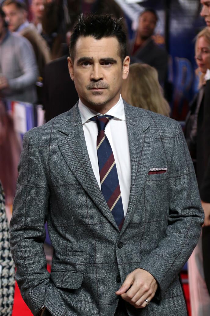 MØRKE LOKKER: Slik er nok de fleste vant til å se Colin Farrell på håret. Foto: Martin Evans / Splash News