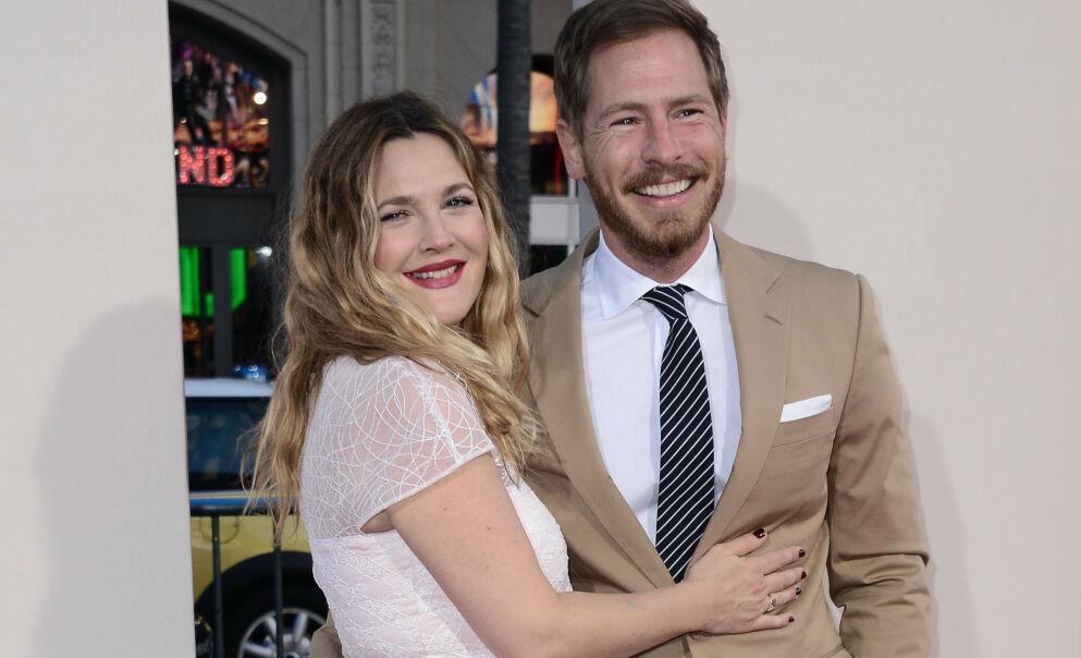 ÅPNER SEG: Skuespiller Drew Barrymore åpner seg om forholdet til eksmannen Will Kopelman. Her er de to i 2014, mens de fortsatt var gift. Foto: Stewart Cook/ REX/ NTB