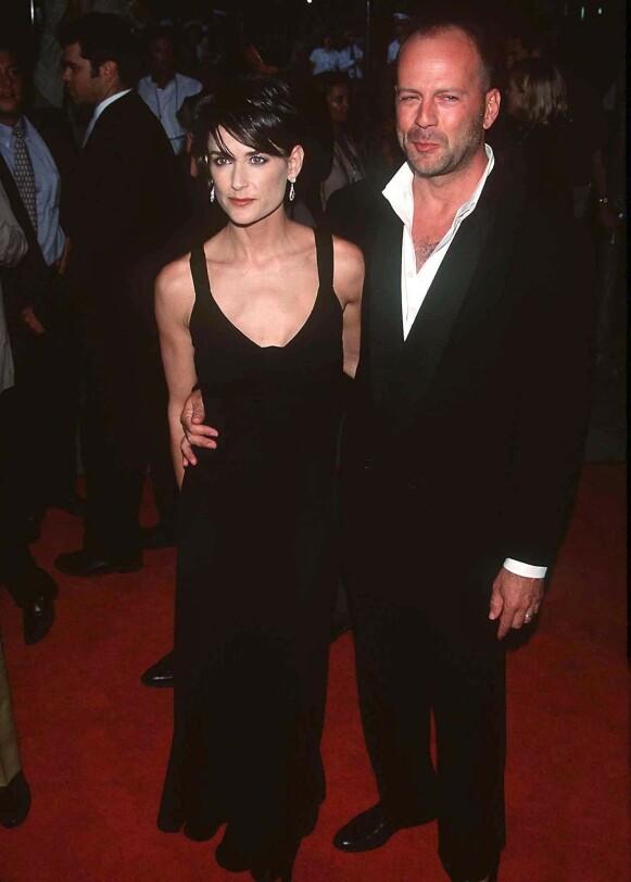 SKILT: Her er Demi Moore og Bruce Willis på den røde løperen i 1997. Året etter kunngjorde duoen at de skulle gå hver til sitt. Foto: REX / NTB