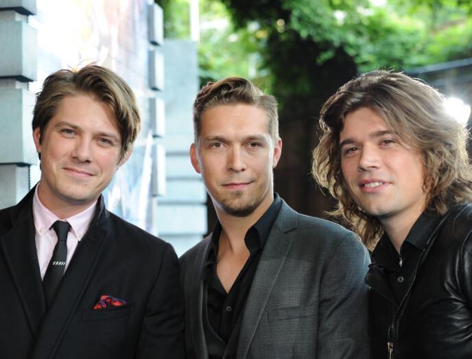 FAMILIELIVET: De tre brødrene i bandet Hanson balanserer rockestjernelivet med farsrollen. Her er de avbildet sammen på en filmpremiere i 2013. Foto: Joanne Davidson / REX / NTB