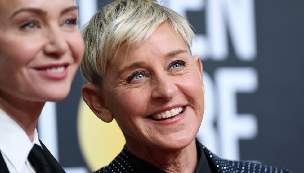 STOPP: Ellen DeGeneres har i en årrekke vært en av verdens mest populære talkshow-verter. Nå er det imidlertid stopp. Her avbildet med kona Portia de Rossi. Foto: Valerie Macon / AFP / NTB