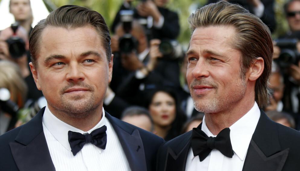 UGJENKJENNELIG?: Nye bilder av Leonardo DiCaprio fra hans kommende film er ute, og New York Post hevder at stjernen ser ugjenkjennelig ut. Nå rister fansen på hodet over avisens påstand. Her er DiCaprio avbildet med Brad Pitt. Foto: Regis Duvignau / Reuters / NTB