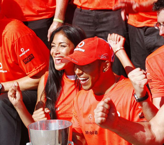 SEIER: Nicole og Lewis etter at sistnevnte hadde hentet hjem nok en seier. Her i Montreal i Canada i 2012. Foto: Lat Photographic / REX / NTB