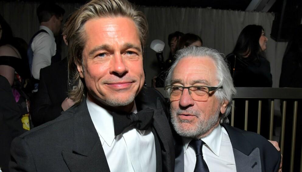 SKADA: Robert De Niro har pådratt seg en skade, og har reist hjem fra filminnspilling i Oklahoma. Her med Hollywood-stjernen Brad Pitt. Foto: Charley Gallay / AFP / NTB