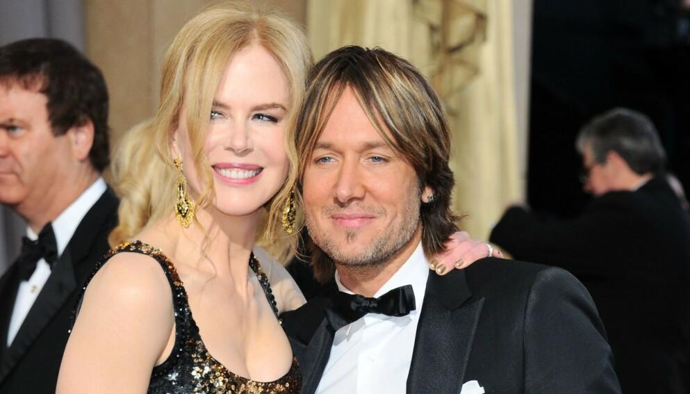 LYKKELIG GIFT: Nicole Kidman og Keith Urban har aldri vært fremmed for å vise kjærligheten de føler for hverandre. Her er paret avbildet i 2013. Foto: Stewart Cook/REX/NTB