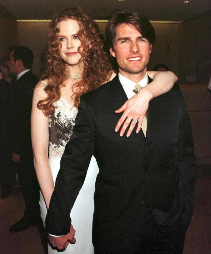 SKILT: Nicole Kidman og Tom Cruise skilte seg i 2001, etter elleve år som gift. Her er eksparet avbildet i 1998. Foto: REX/NTB