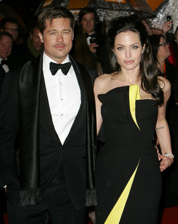UENIGE: Siden 2016 har Brad Pitt og Angelina Jolie ikke klart å bli enige om hvem som skal ha ansvaret for de seks barna. Her i 2009. Foto: REX / NTB